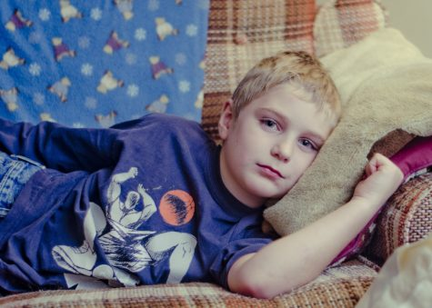 Boy laying on couch
