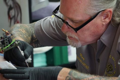Tattoo Artists Face Serious Risk Of Neck, Back Injuries, Study Finds