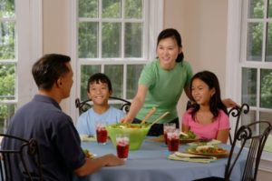 Family enjoying home-cooked dinner