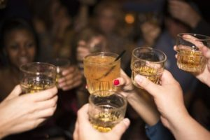 Group of people taking shots, drinking alcohol