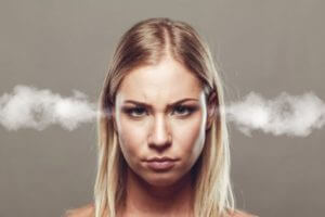Angry woman with smoke coming from ears