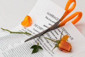 Divorce; marriage certificate cut by scissors