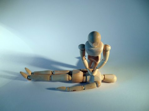 Wooden figures modeling CPR