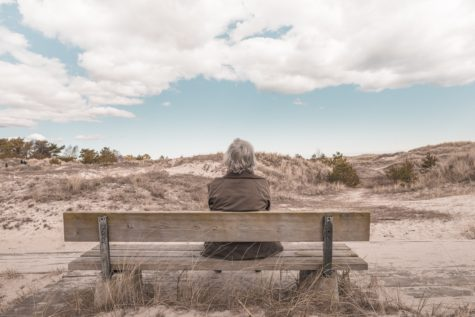 Elderly person sitting alone