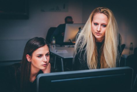 Women looking at computer in office