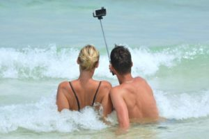 Couple taking a selfie at the beach