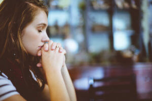 Woman thinking or praying