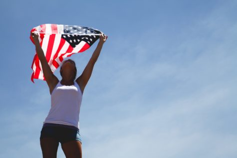 Girl holding up American flag