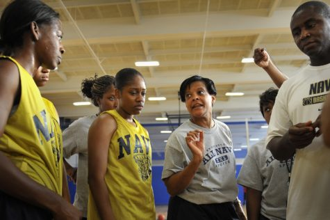 All-Navy women's basketball team assistant coach Diane Richardson mentors prospective players as they run through drills.