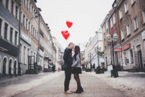 Couple kissing in middle of street