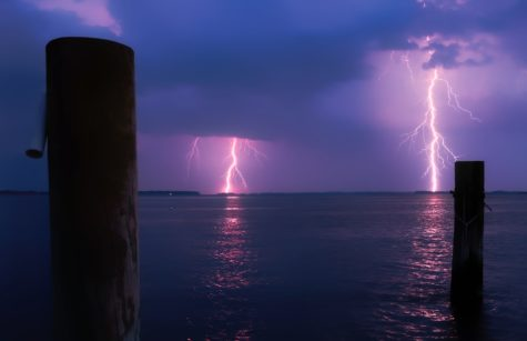 Lightning strikes over ocean
