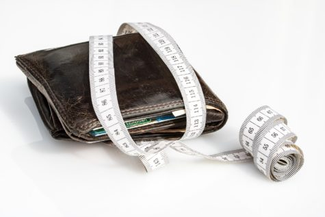 Wallet and measuring tape