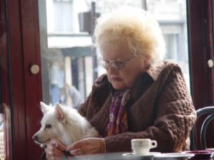Sad woman with dog in coffee shop