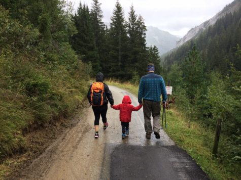 Couple walking with child on hiking trail