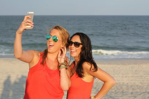 Women snapping a selfie at the beach