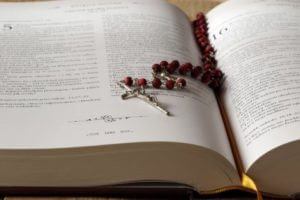 Rosary laying on Bible