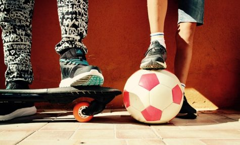 Boys with soccer ball, skateboard