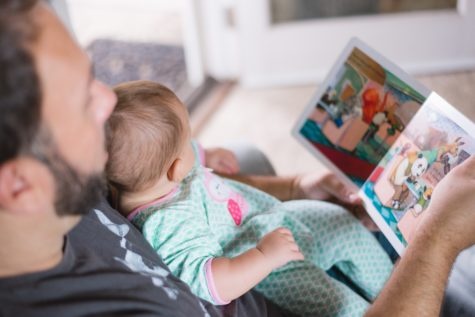 Father reading book to baby