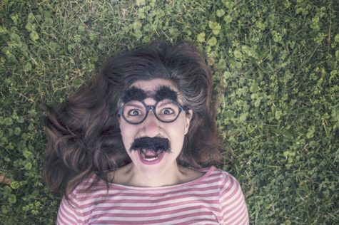 Woman wearing gag Groucho Marx glasses