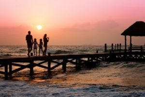Family on a pier at sunset