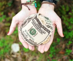 Generosity -- person holding out money in hands