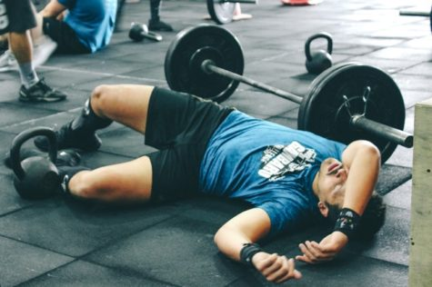 Man lying on floor at gym