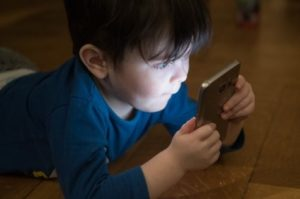 Little boy looking at smartphone