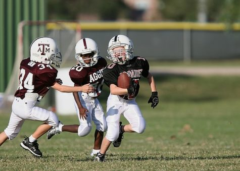 Children playing tackle football