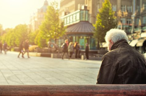 Elderly man sitting alone