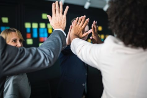 Group of office workers high-fiving