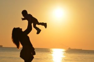 Mother with child at sunset
