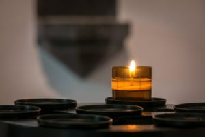 Candle burning in church