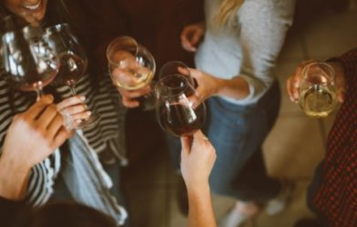 Women toasting with glasses of wine