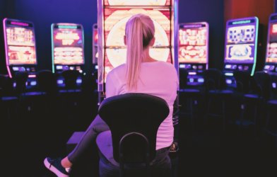 Woman in front of slot machine