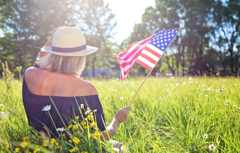 Woman holding American flag