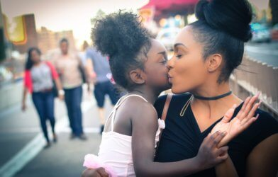 Woman kissed by daughter