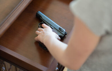 Child with gun in drawer