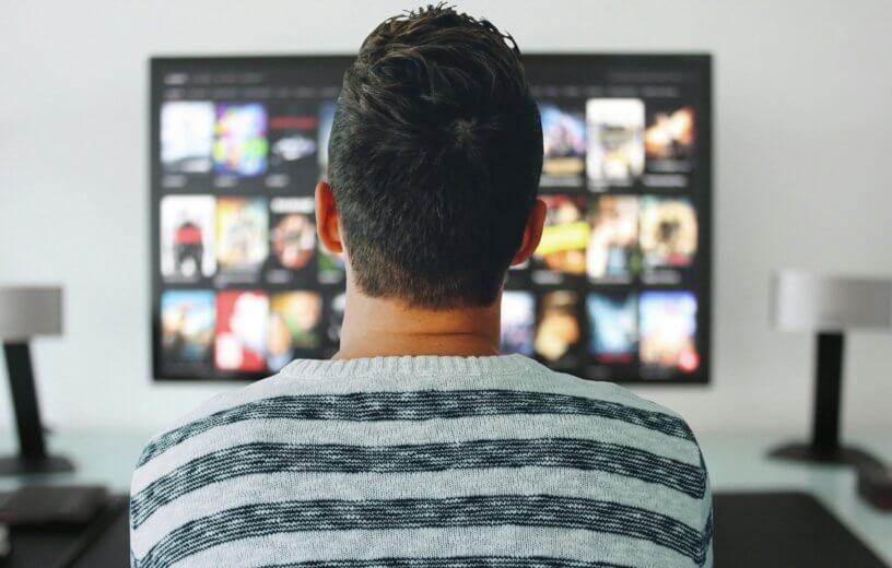 Person watching movies on TV