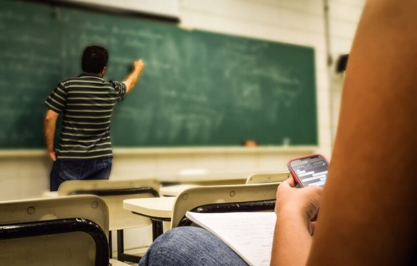 Student on phone in college class