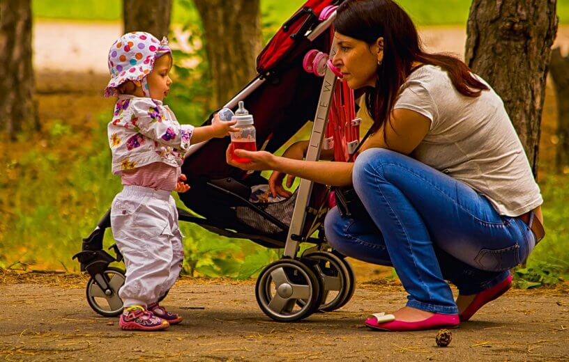 Woman with baby and stroller
