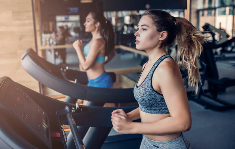 Women running on treadmill