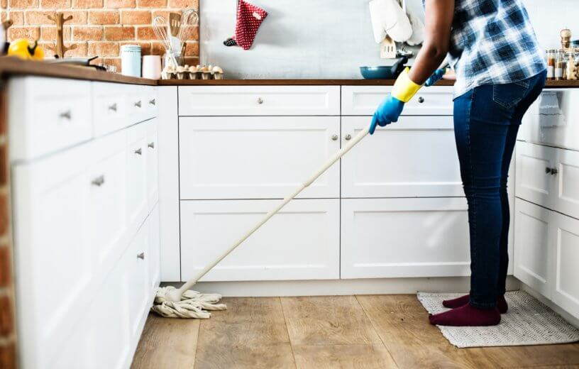 Person mopping a kitchen