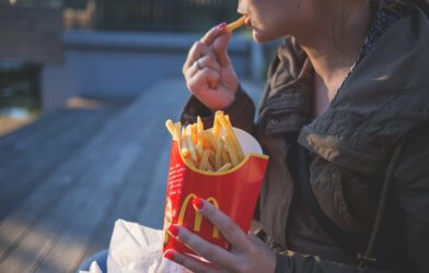 Woman eating McDonald's fries