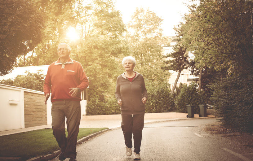 Older couple taking a brisk walk