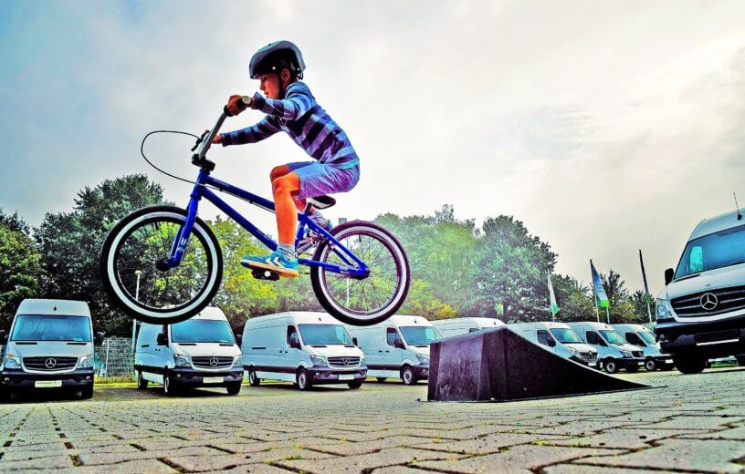 Child wearing helmet while on bicycle