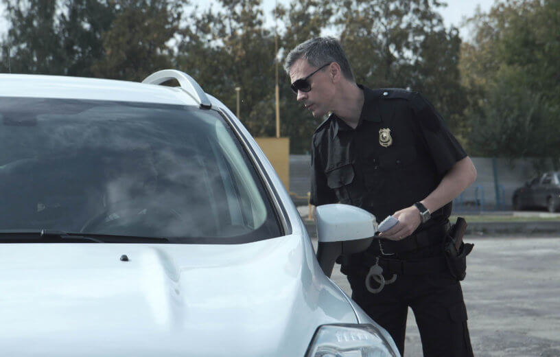 Police officer stopping the driver of a vehicle