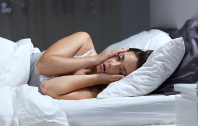 Woman struggling with sleep