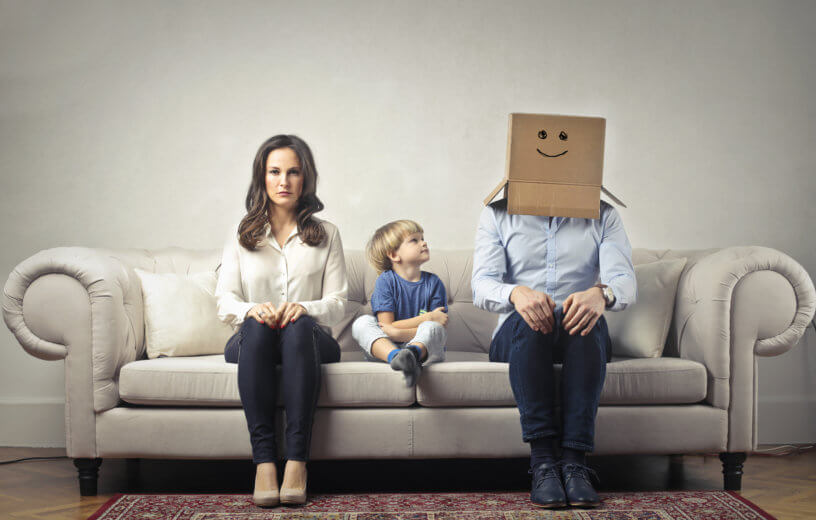 Mother with young son, Father with box on his head