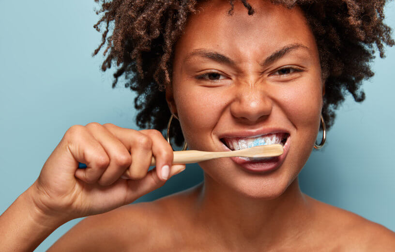 Woman brushing her teeth