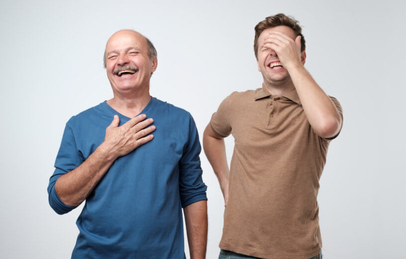 Dad jokes: Father, son laughing after telling a jokeDad jokes: Father, son laughing after telling a joke